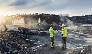 Two workers in rock quarry