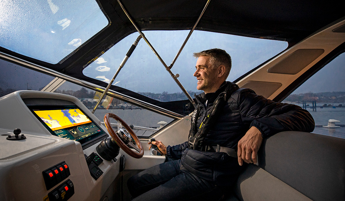 Man at helm of boat